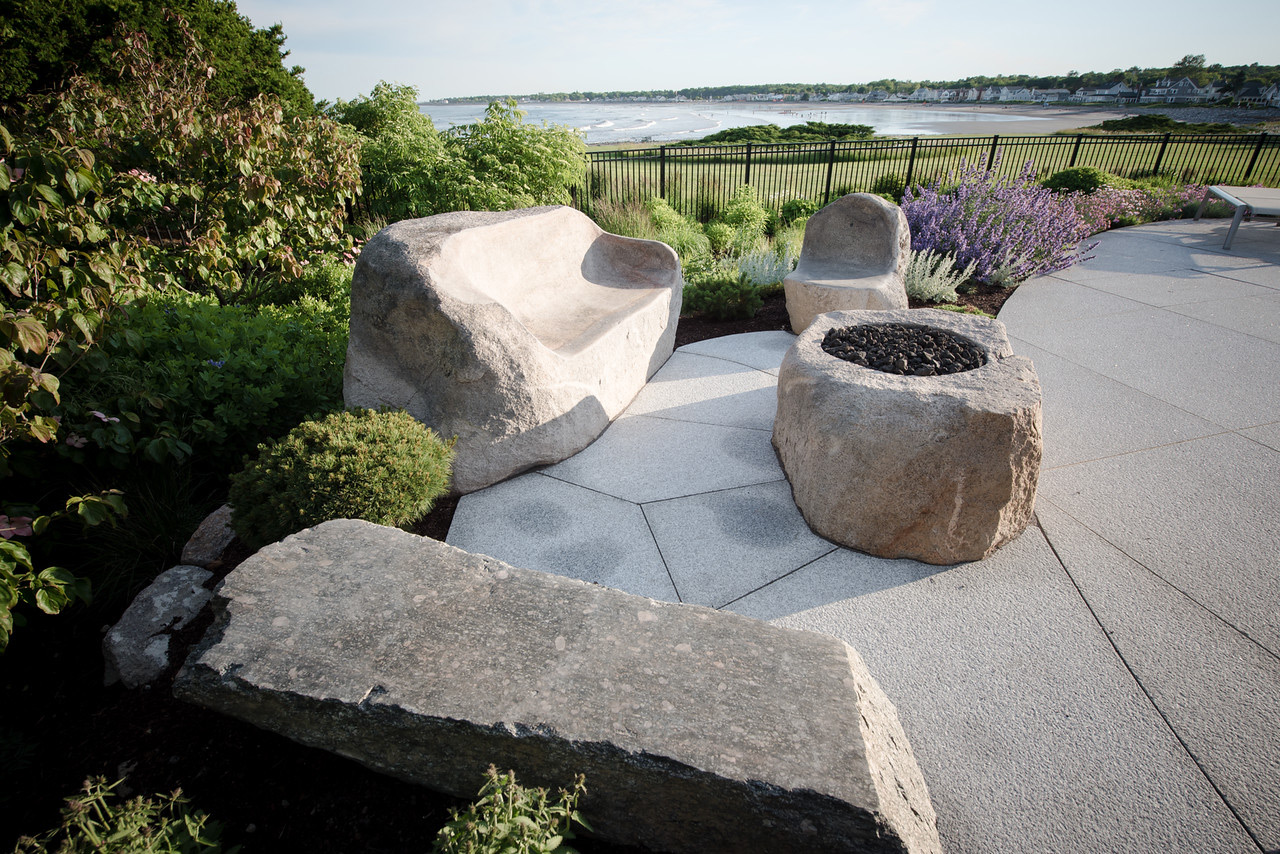 Fire Pit with hand-carved boulder furniture – Seacoast NH residence